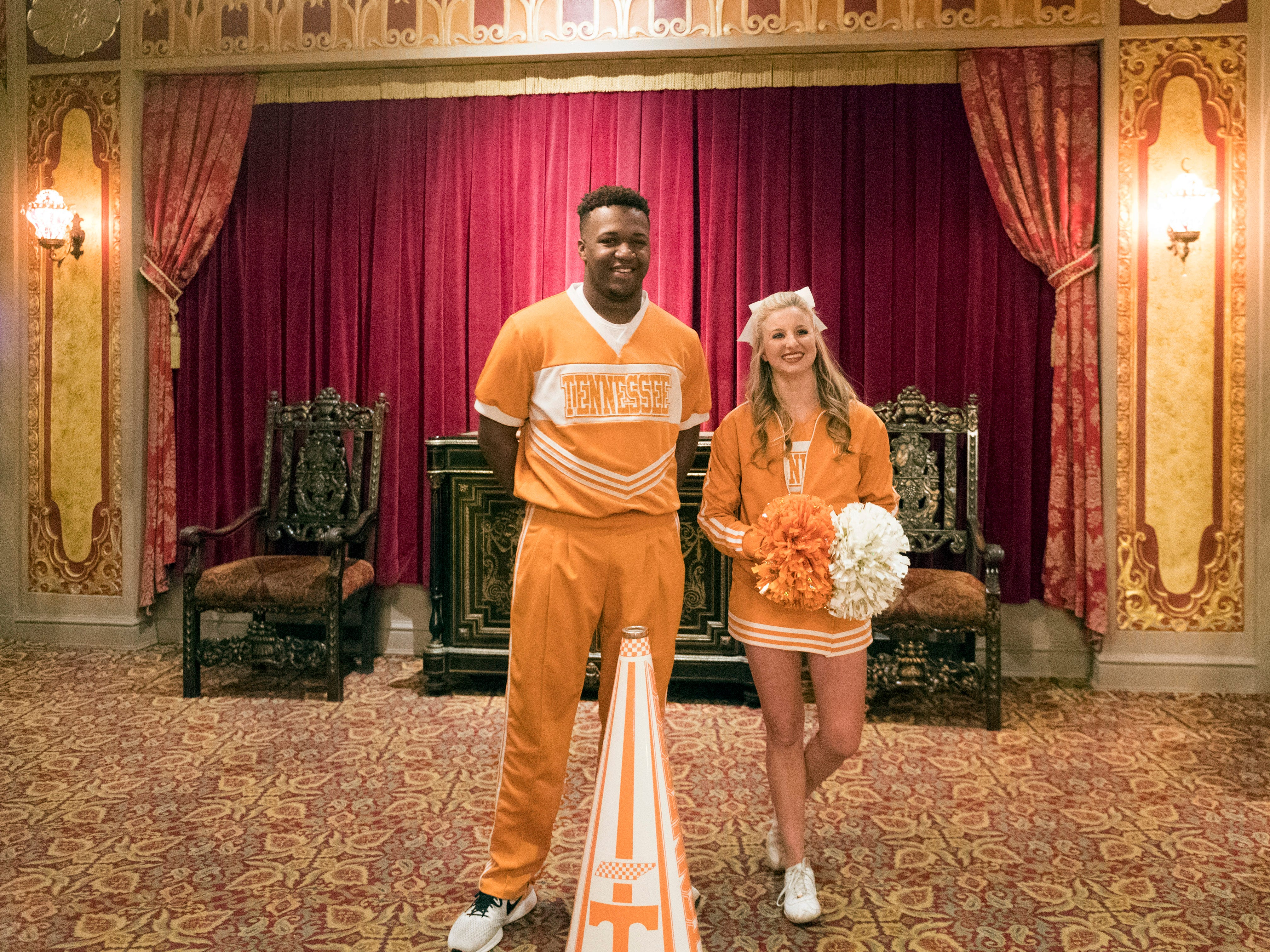 University of Tennessee cheerleaders Kahlil Bostick and Megan Stallings greet Tennessee fans as they arrive for the Signing Day celebration at the Tennessee Theatre on Wednesday, February 7, 2018.