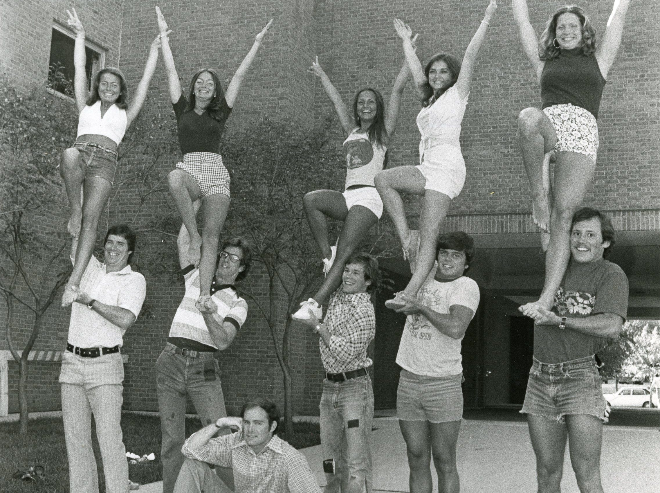The 1975-76 UT cheer team included (bases) Rex Horton, Wear Culvahouse, Hamp Morrison (Smokey), John Bibb, Steve Pickard, Ernie Lehning; (flyers) Rosemary Keim, Julie Brown, Cindy Green, Mary Hanes Lancaster and Vicki Hays.