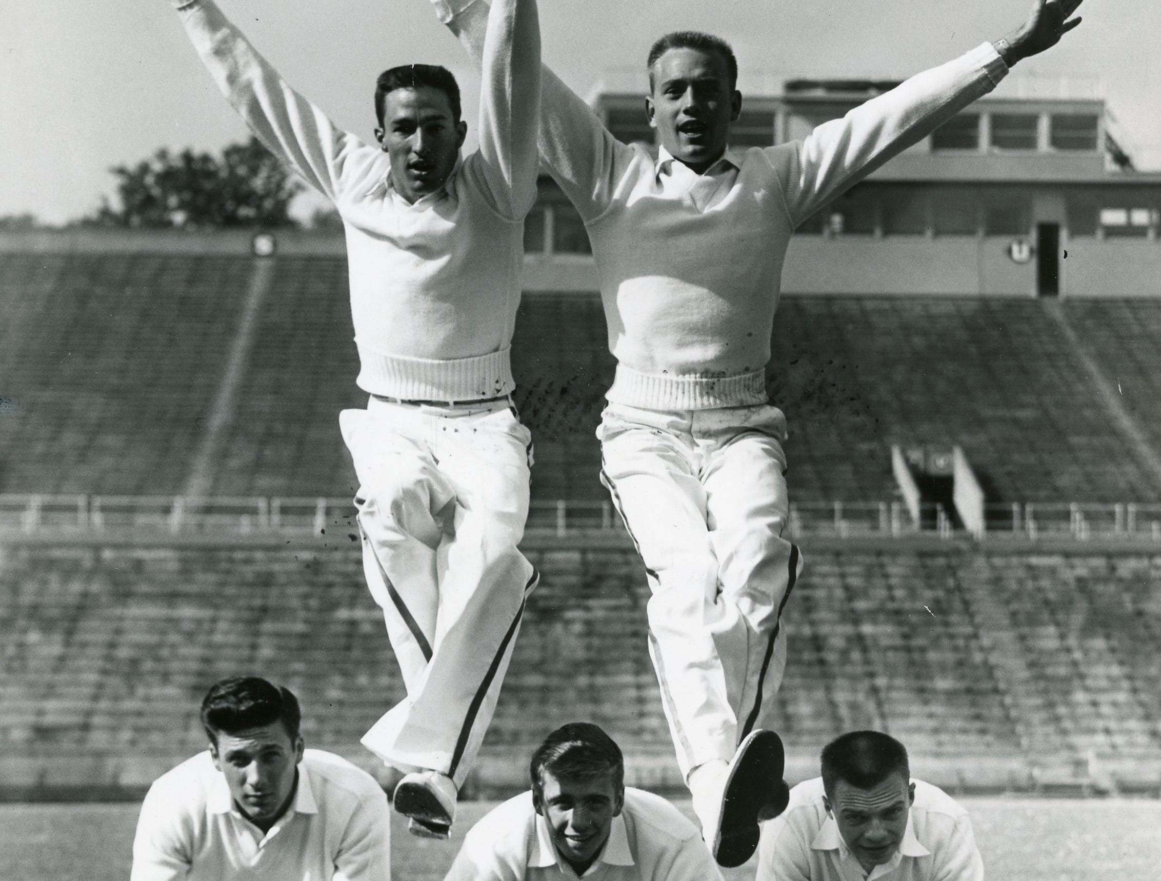 UT cheerleaders perform a stunt for the photographer in this September, 1955 photo. Pictured are (front) Dave Dean, Bill Weller, Gene Fox; (back) Jerry Adams and Bill Sears.