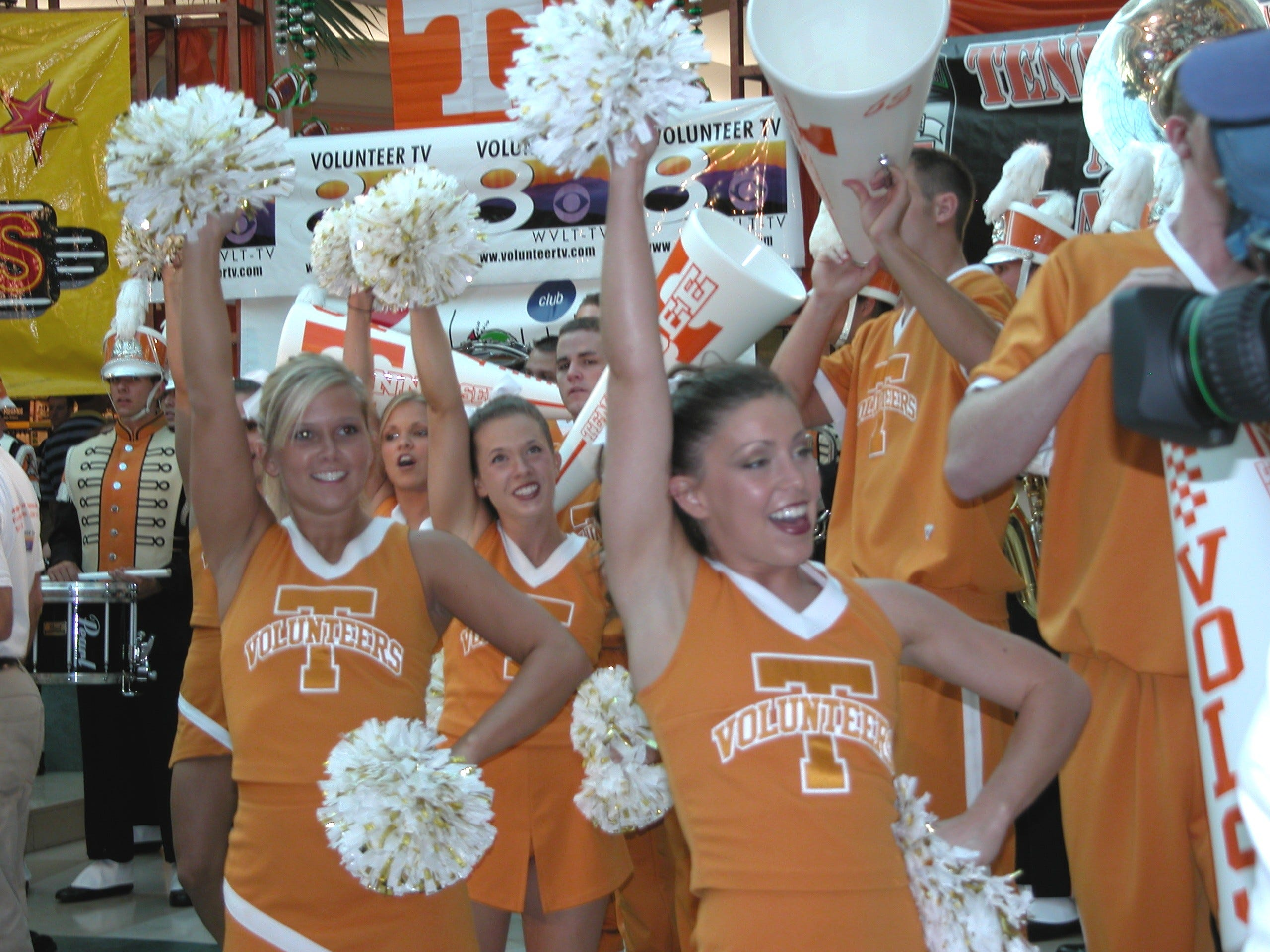 "The University of Tennessee Cheerleaders, along with the UT Pep Band, get the crowd ready for the school's home opener football game during the Channel 8-TV ""I'm All Vol"" Pep Rally Sept. 1 at West Towne Mall."