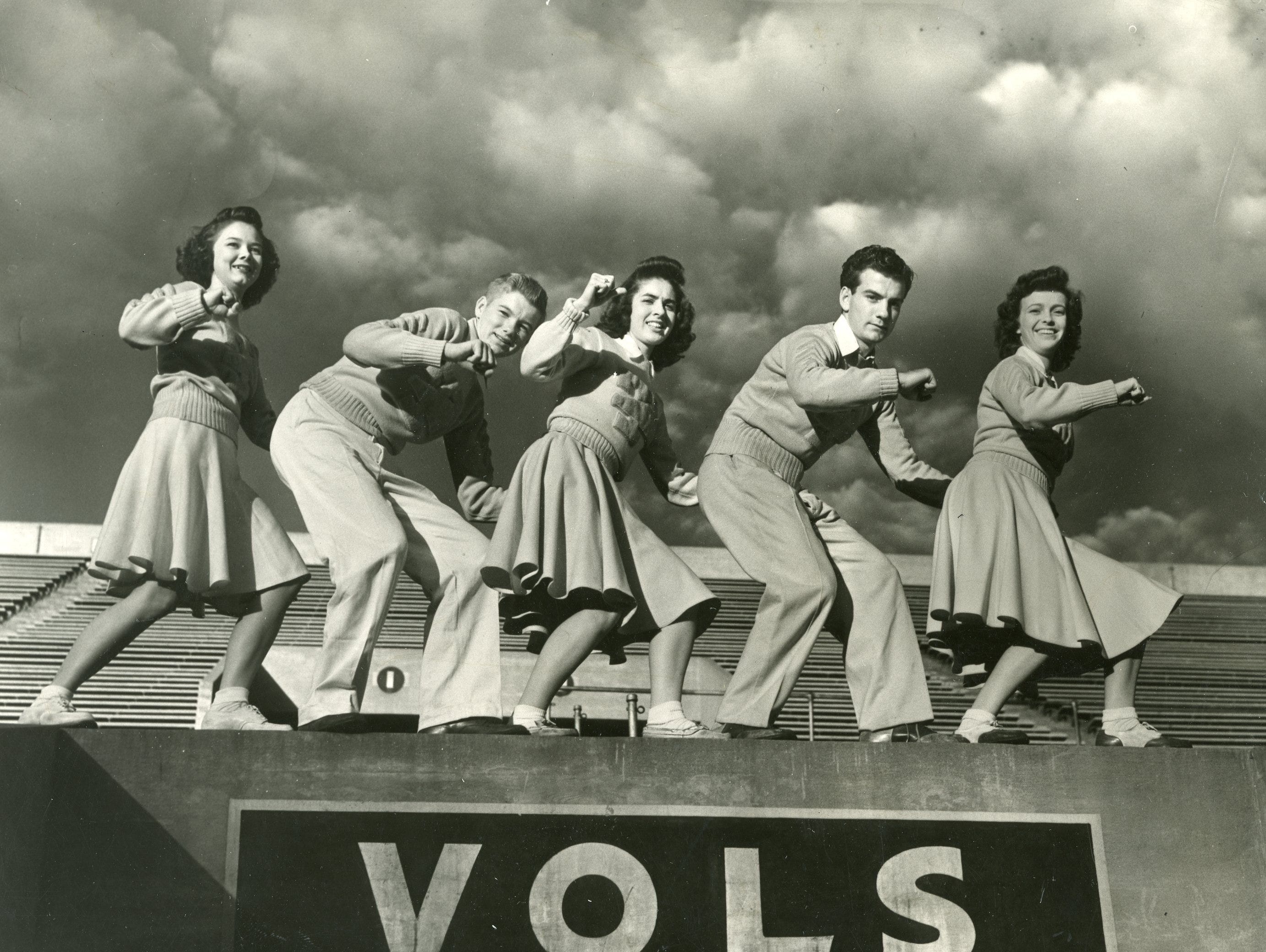 Members of the 1945 UT cheer team included Ann Gordon Dempster, Johnny Sterchi, Charlotte Poe, Charles Wolfenbarger and Buna Rudolph.