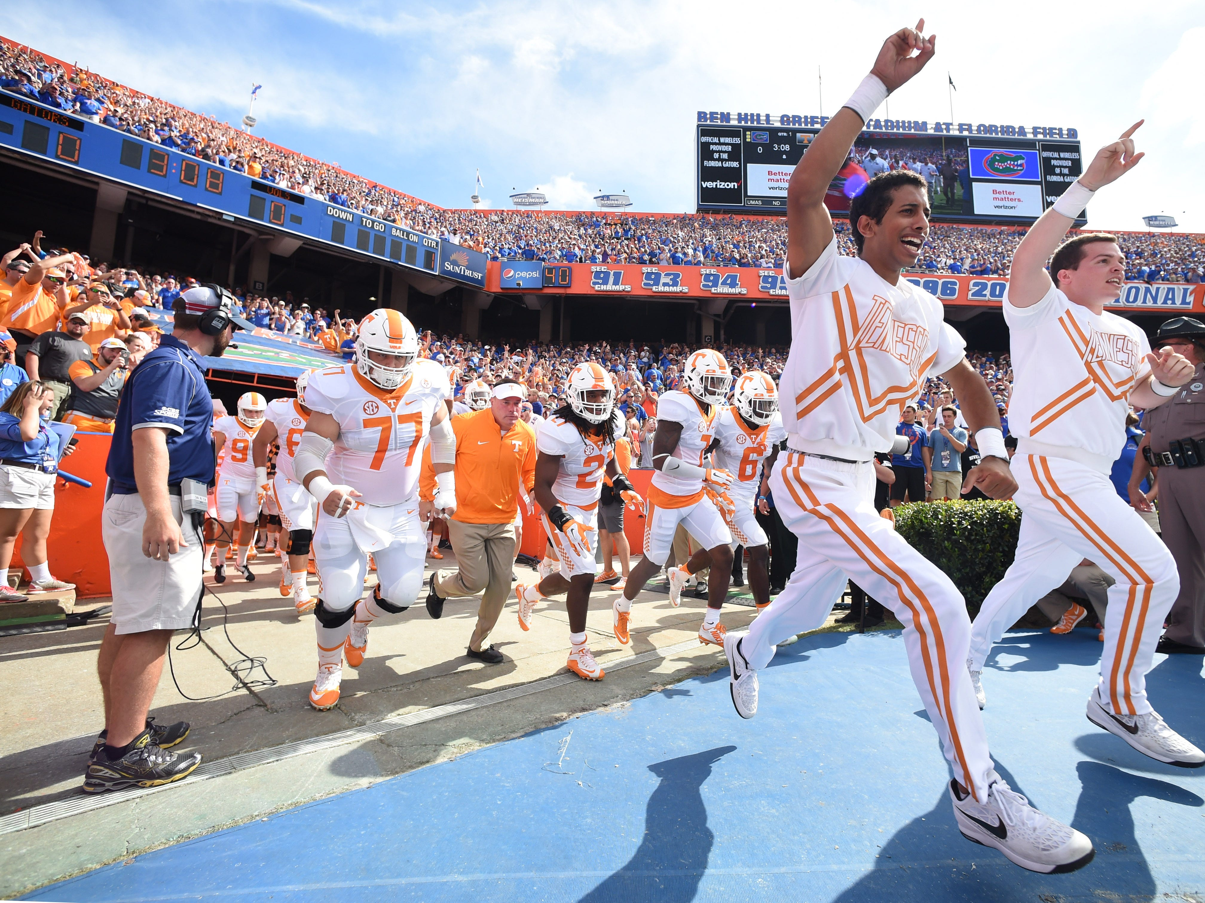 Tennessee cheerleaders lead Tennessee head coach Butch Jones and his team onto the field for the first half against Florida at Ben Hill Griffin Stadium in Gainesville, Fla. on Saturday, Sept. 26, 2015.