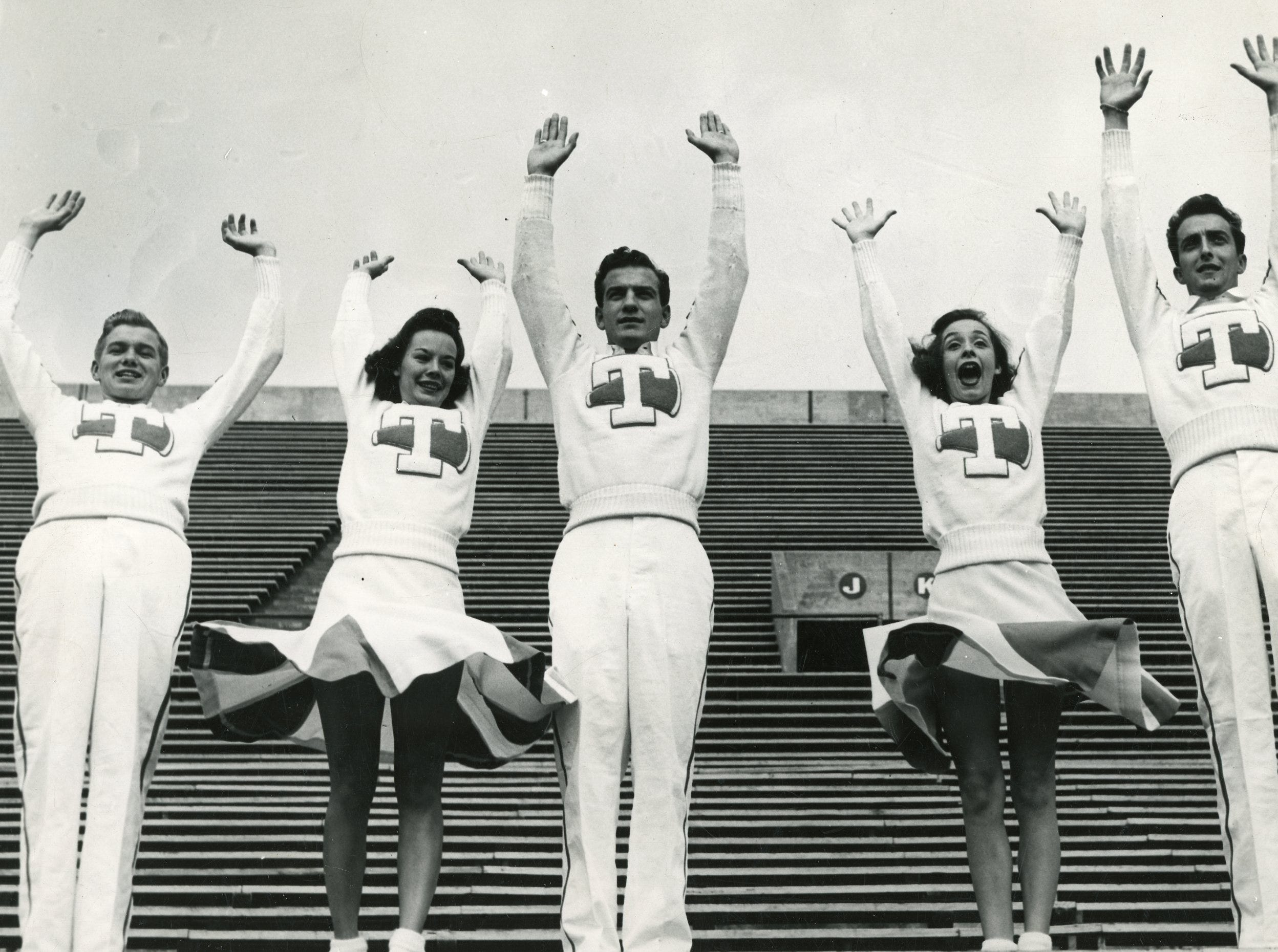 1946 UT cheerleaders John Sterchi, Sis McCullough, Charles Wolfenbarger, Mary Lee Ewell and Tandy Wilson.
