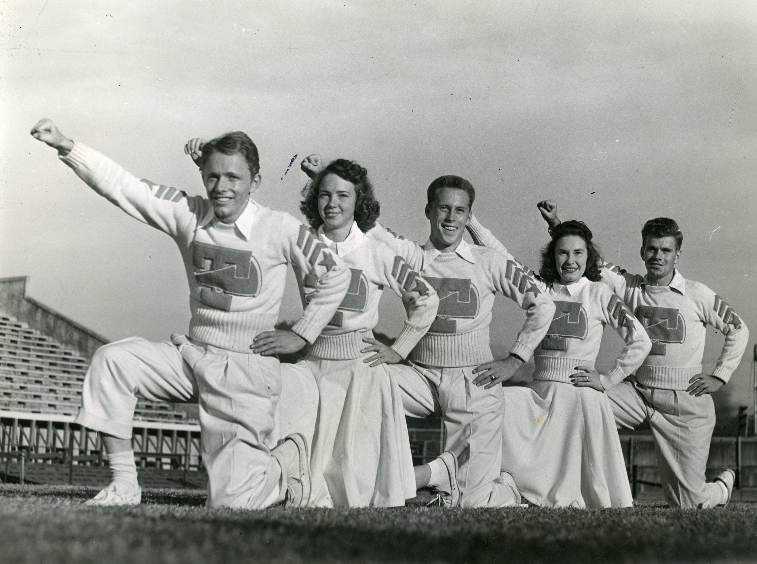 UT cheerleaders Kyle Crowther, Helen Childs, I.T. Sliger, Peggy Roberts and Bill Killian, October, 1941.