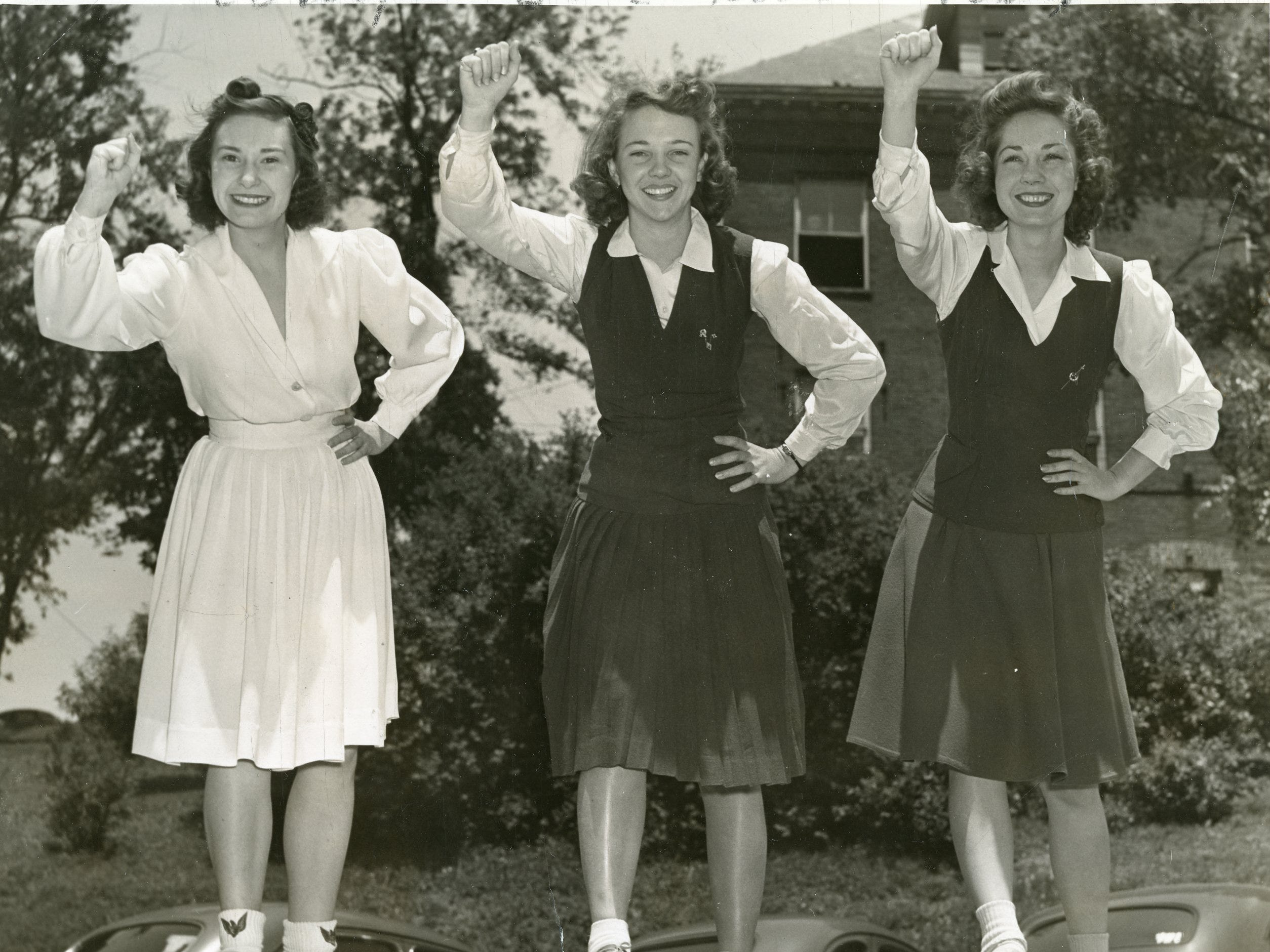 Peggy Roberts, Helen Childs and Margaret Haynes, members of the UT cheer squad, 1941.