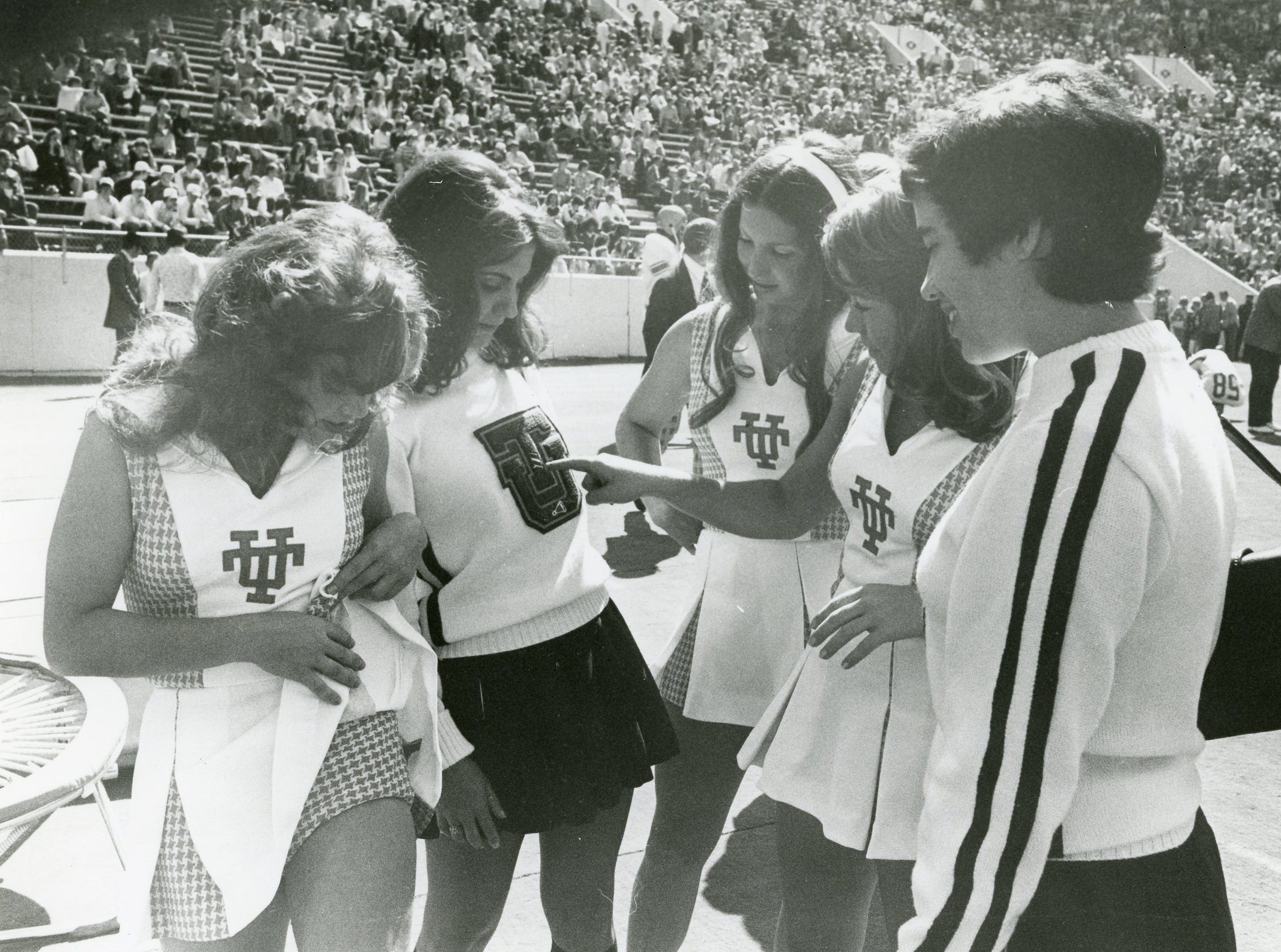 UT cheerleaders chat with TU (Tulsa) cheerleaders. Pictured are Mary Hanes Lancaster, Mary Ann Dunnagan (TU), Vicki Hayes, Rosemary Keim and Carolyn Ely (TU).