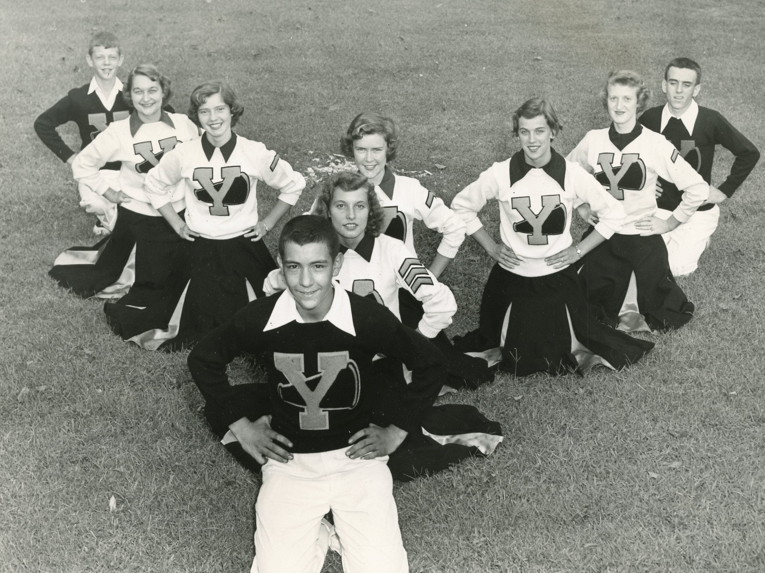 Young High cheerleaders in an undated photo. Pictured are (from front) Faymer Hutchens, Marianne Davenport, (back) Bill Goodwin, Judy Weaver, Barbara Price, Glenda Giles, Anne Beard, Faye Tucker and Clyde Julian.