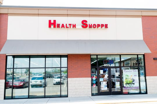 The exterior of Eddie's Health Shoppe in Suburban Plaza in West Knoxville, Tennessee on Thursday, July 26, 2018. CBD, one of 104 chemical compounds found in cannabis, has been gaining popularity recently for its pain and anxiety relieving properties