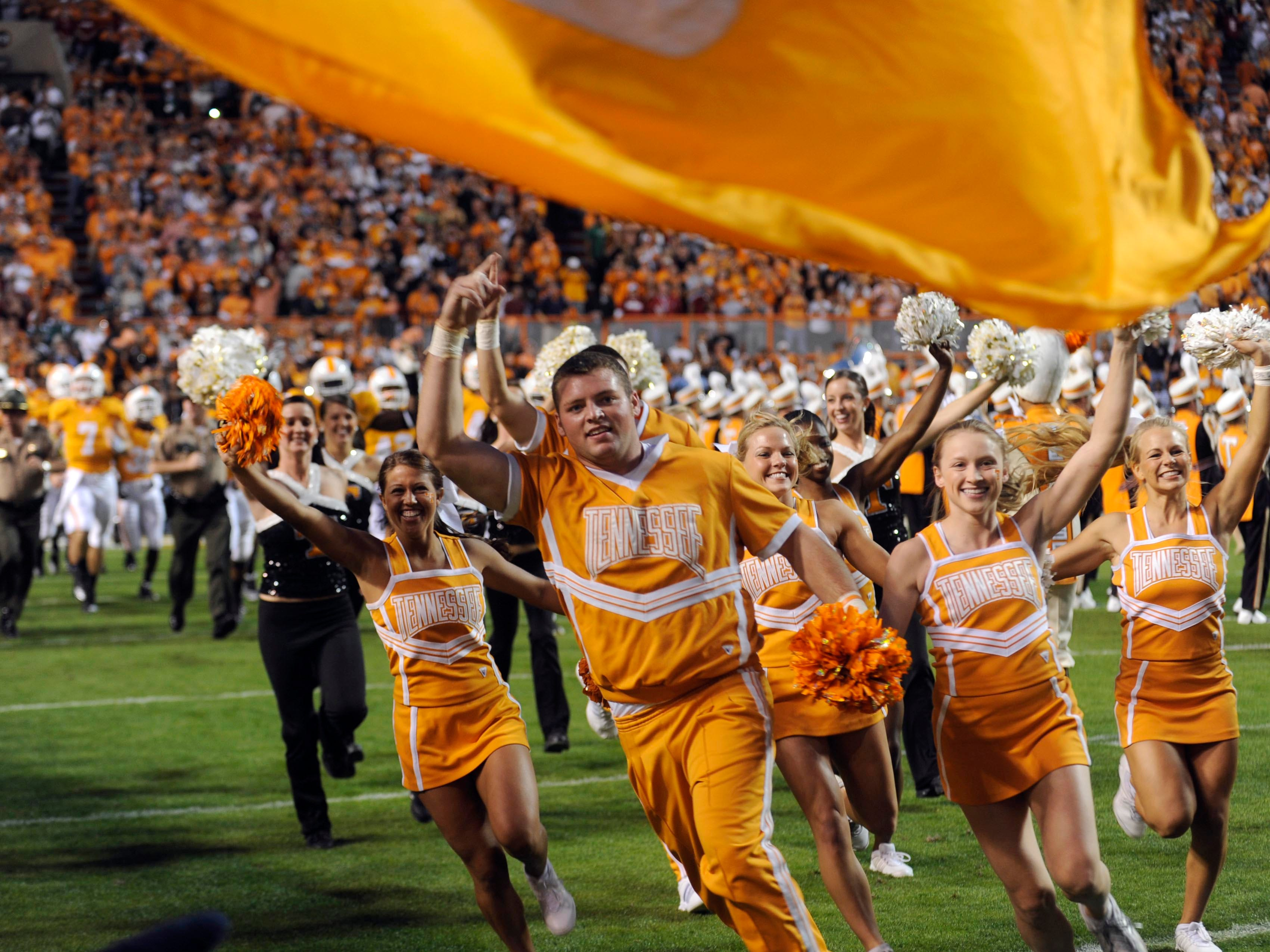 Tennessee cheerleaders lead the team onto the field before the game  against Alabama Saturday, Oct. 23, 2010 in Neyland Stadium in Knoxville.