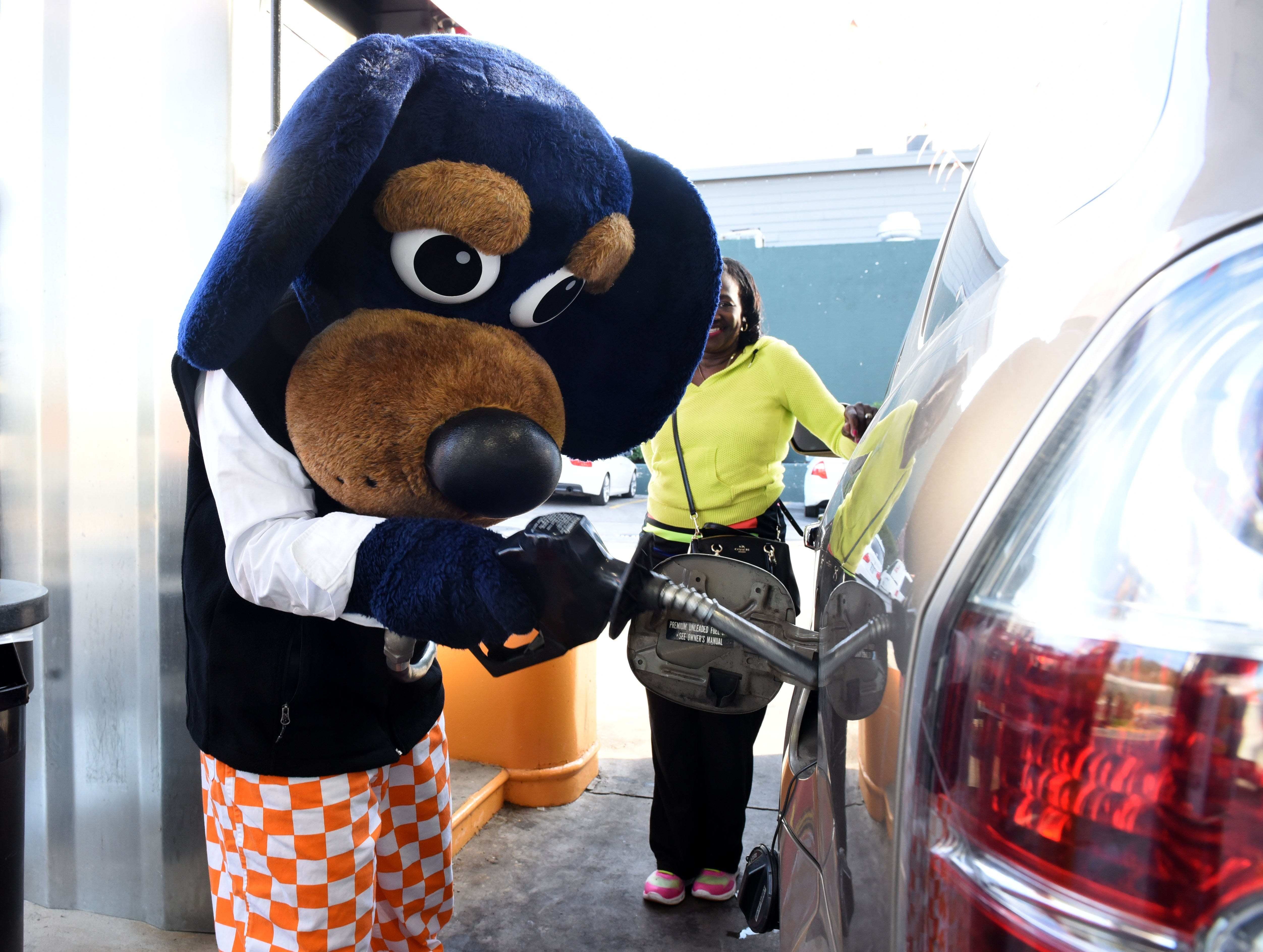 The University of Tennessee Spirit Team mascot Smokey Jr. pumped gas for Yolanda Hunt McFadden at Pilot station on Cumberland Ave to raise money for United Way Tuesday, Oct. 11, 2016.