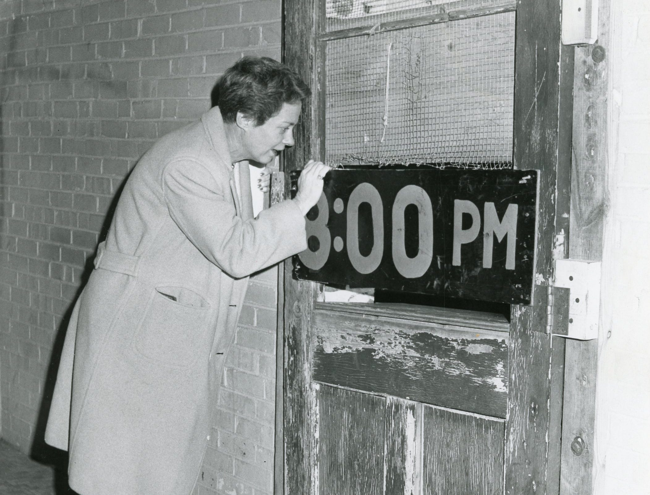 Marion Chapman checks out Young High School during a Saturday tour, January, 1964.