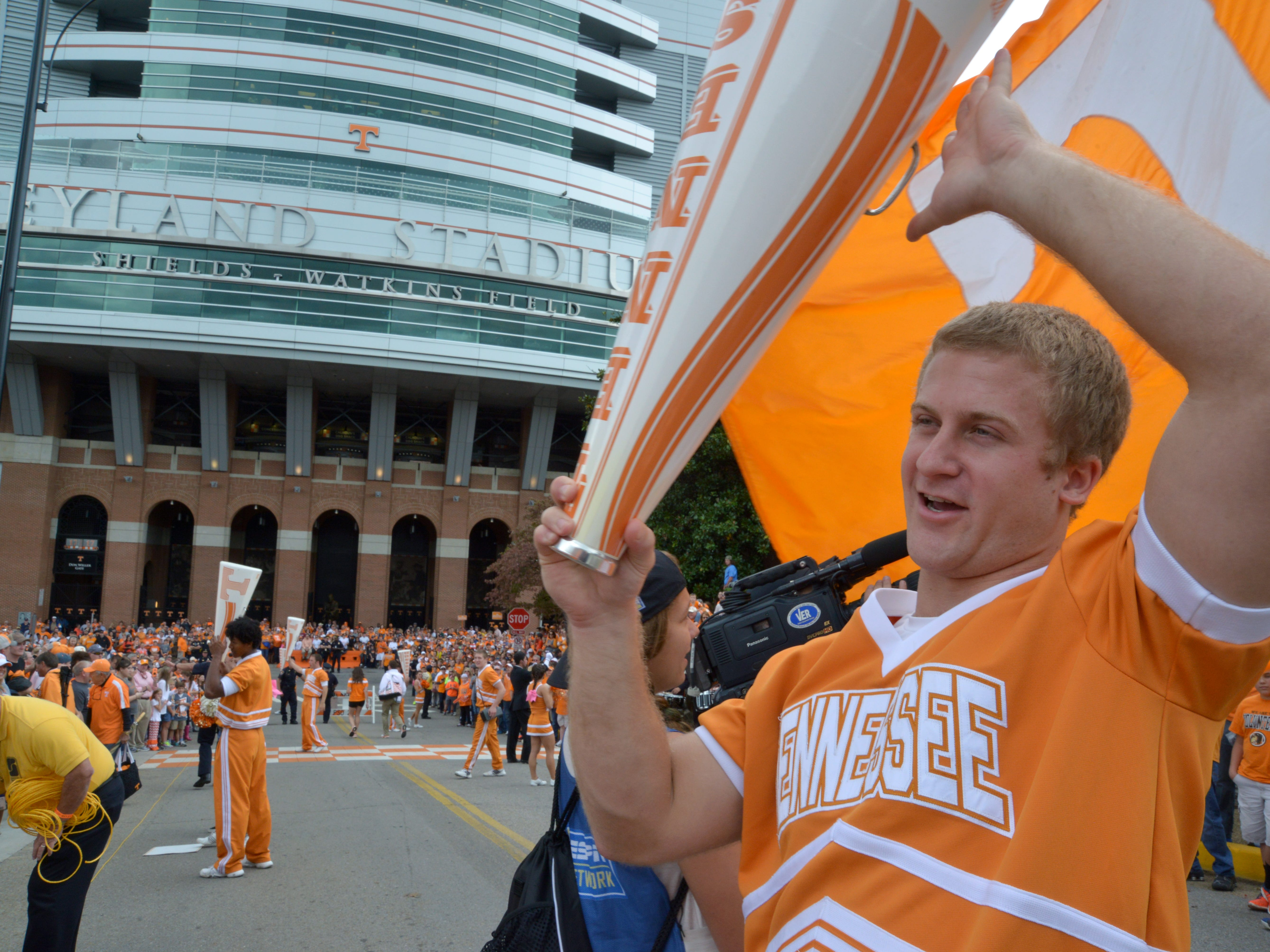 UT Cheerleader Taylor Rowland prepares the crowd the for Vol Walk before the game against UTC in Neyland Stadium, Saturday, Oct. 11, 2014 in Knoxville, Tenn.
