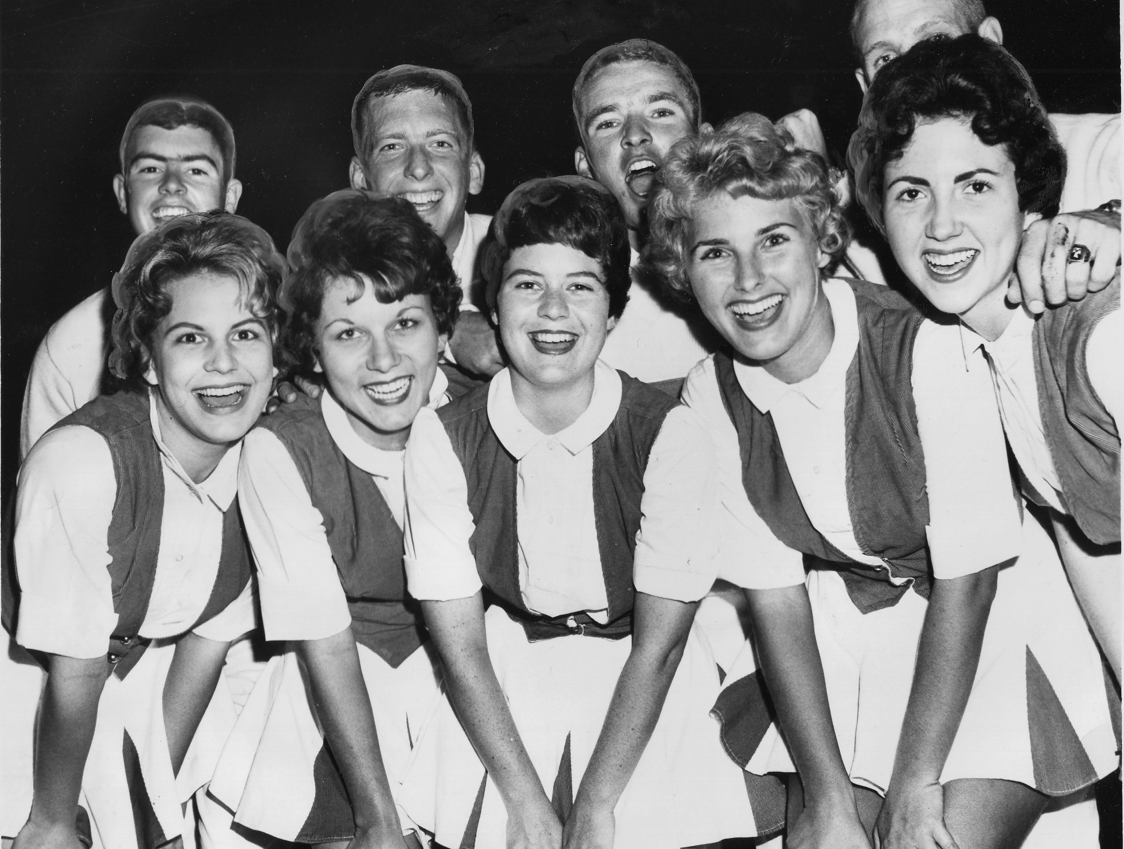 University of Tennessee cheerleaders are pictured on Oct. 15, 1961. Front row, from left, Janet Stanford, Dola Terry, Ann Dixon, Wallene Threadgill, and Martha Dempster. Back row, from left, Tammy Leek, Bill Cowan, Gary Meyer, and Frank Bowyer. (News Sentinel Archive)