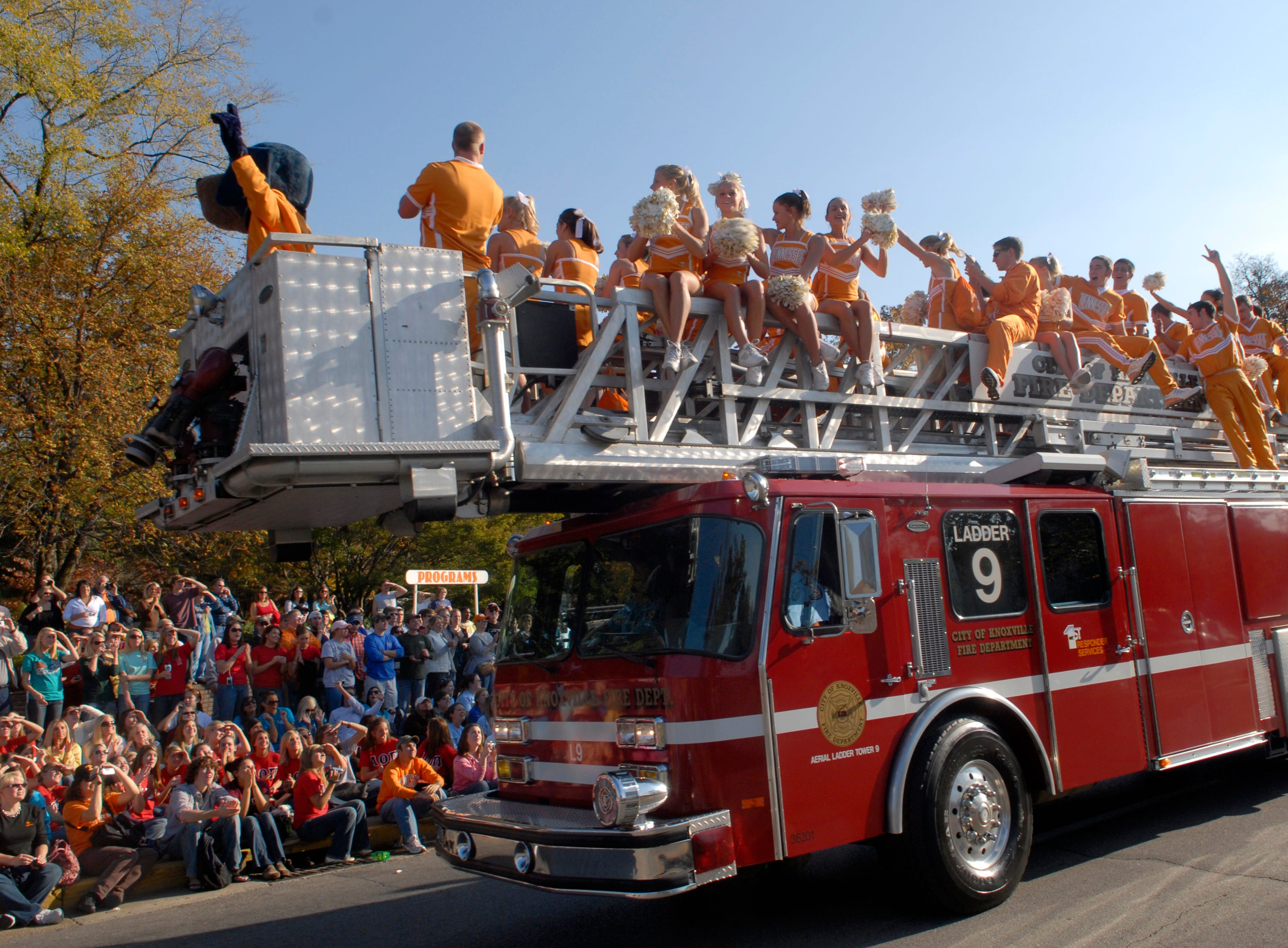 University of Tennessee cheerleaders wave to the crowd from atop a ladder truck during the UT Homecoming Parade along Volunteer Blvd, Friday. November, 2, 2007