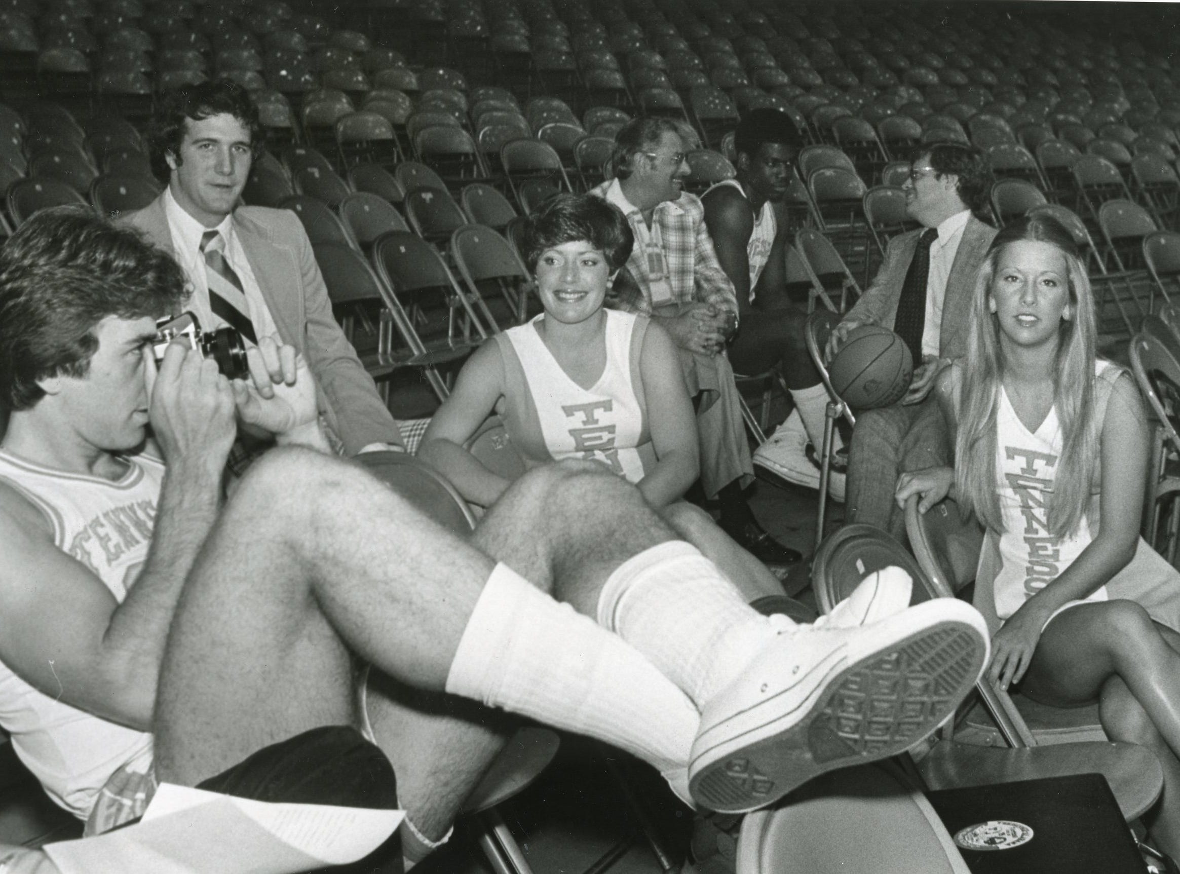 Ernie Grunfeld takes a photo as UT cheerleaders Sandy Reel and Pam Johnston look on in this October, 1976 photo.