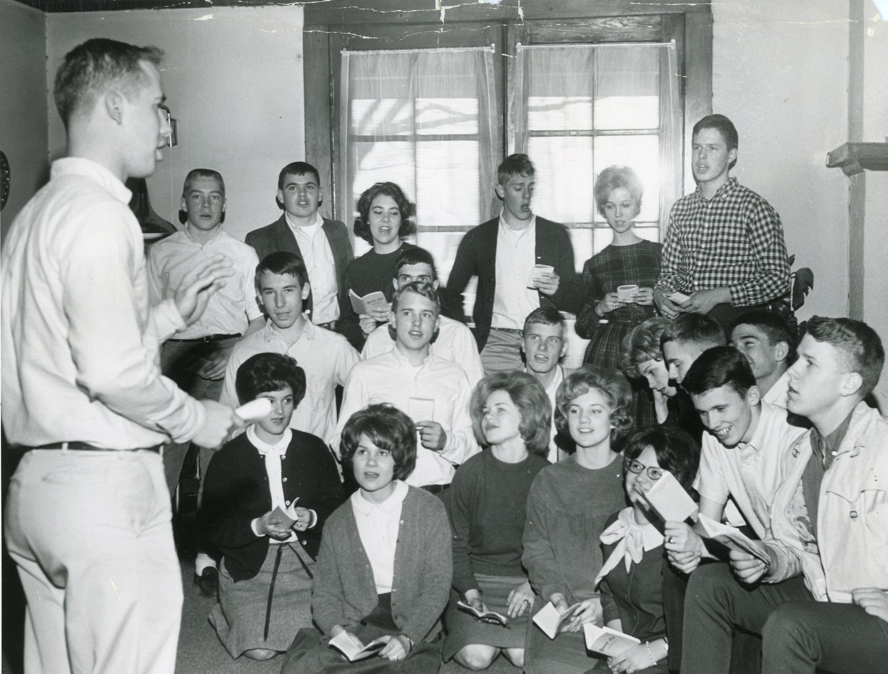 Young High School Young Life Club, featuring UT Young Life leader Dan Batson, far left. March, 1964.