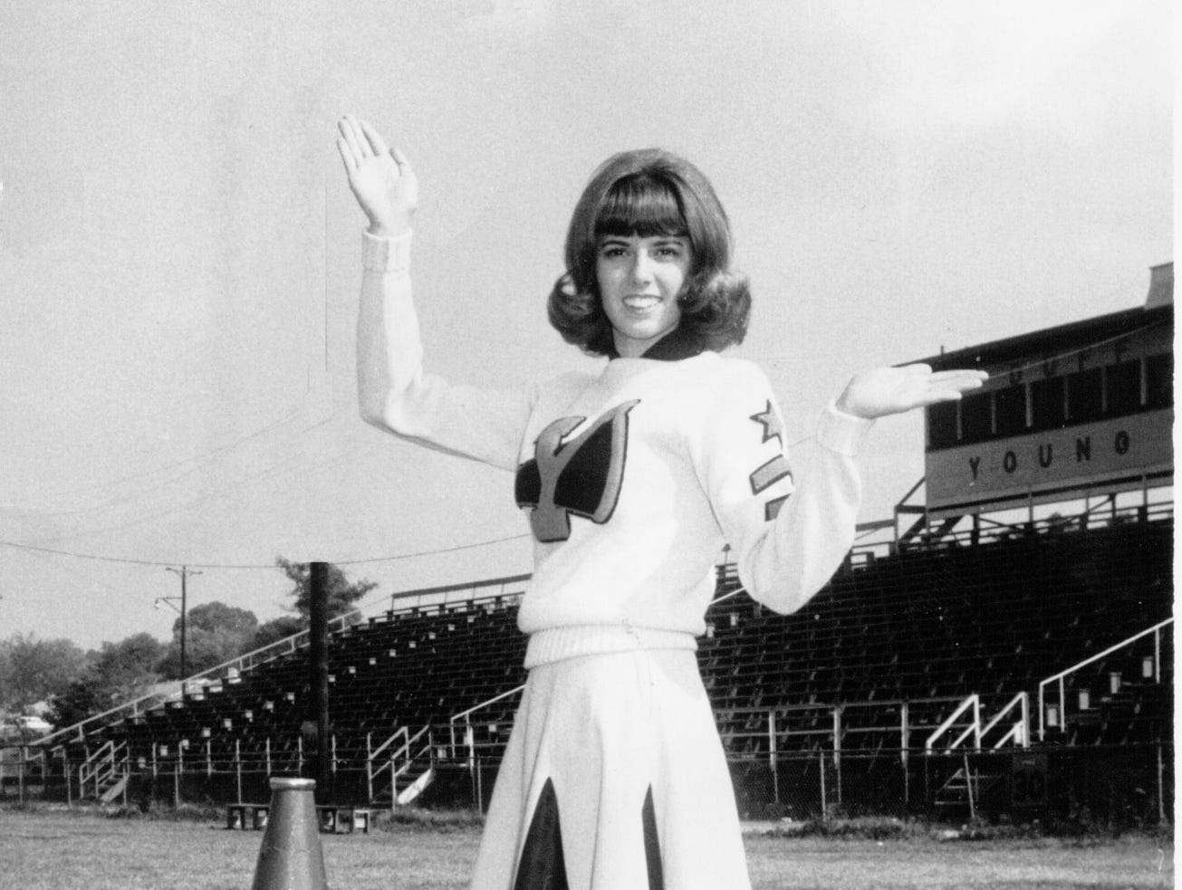 Young High School cheerleader Mary Ann Hill in the 1960s.