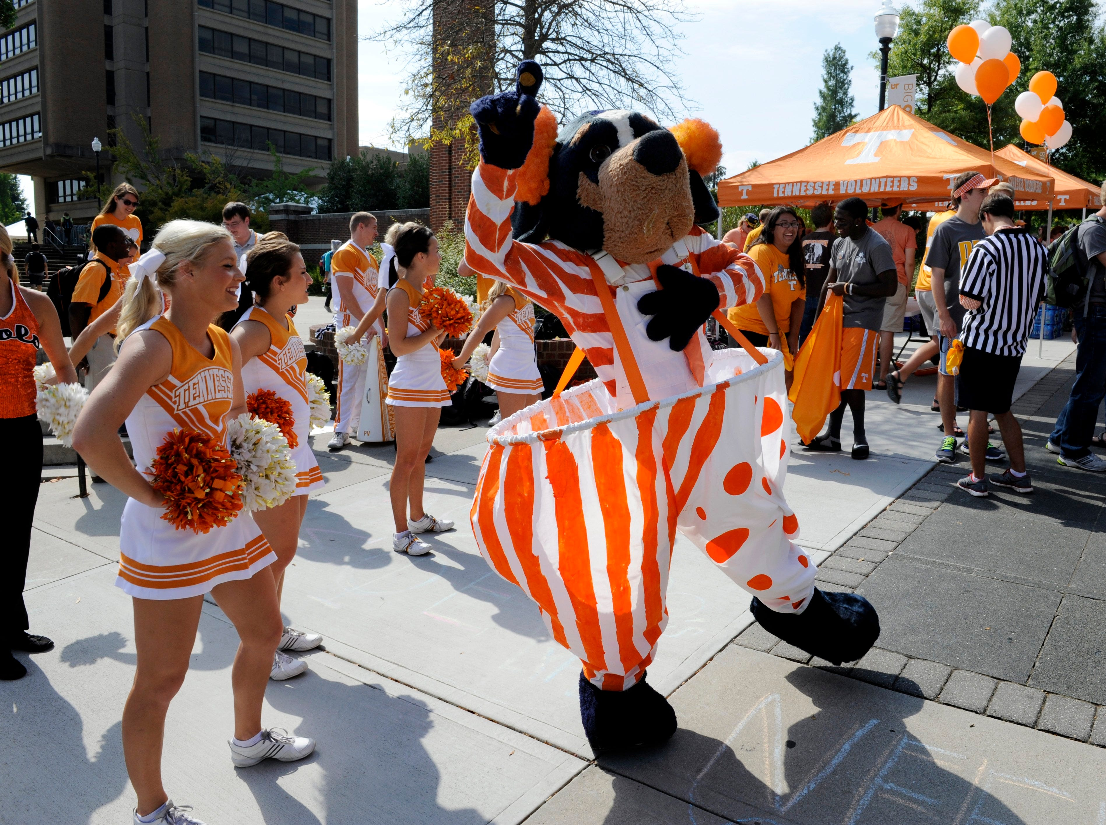 University of Tennessee mascot Smokey dances with the UT Cheerleaders at a 60th birthday party Friday, Oct. 4, 2013 hosted by UT Student Services and the Student Alumni Association on campus.