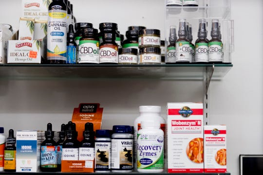 CBD oils for sale on a shelf at Eddie's Health Shoppe in Suburban Plaza in West Knoxville, Tennessee on Thursday, July 26, 2018. CBD, one of 104 chemical compounds found in cannabis, has been gaining popularity recently for its pain and anxiety relieving properties