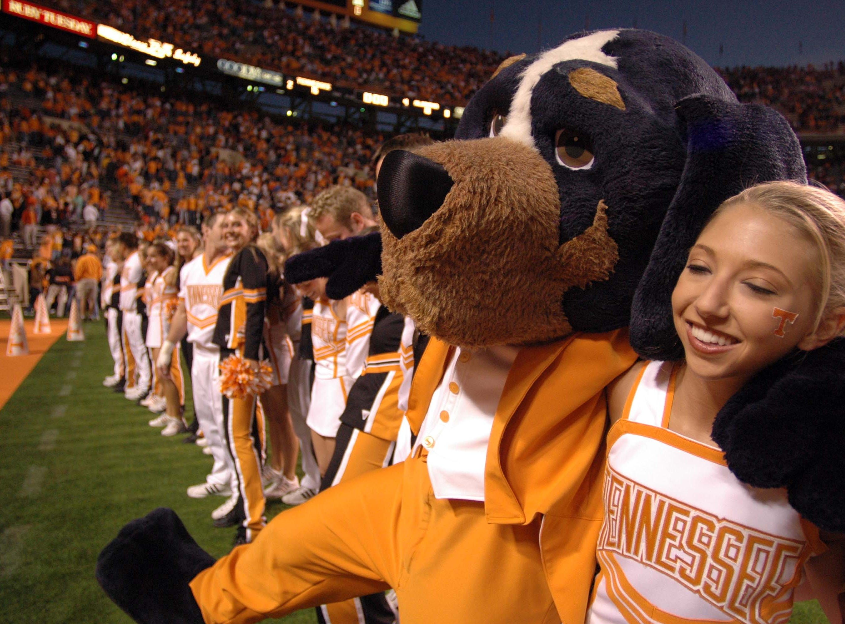 Smoky and the Tennessee cheerleaders celebrate a victory over Alabama at Neyland Stadium.