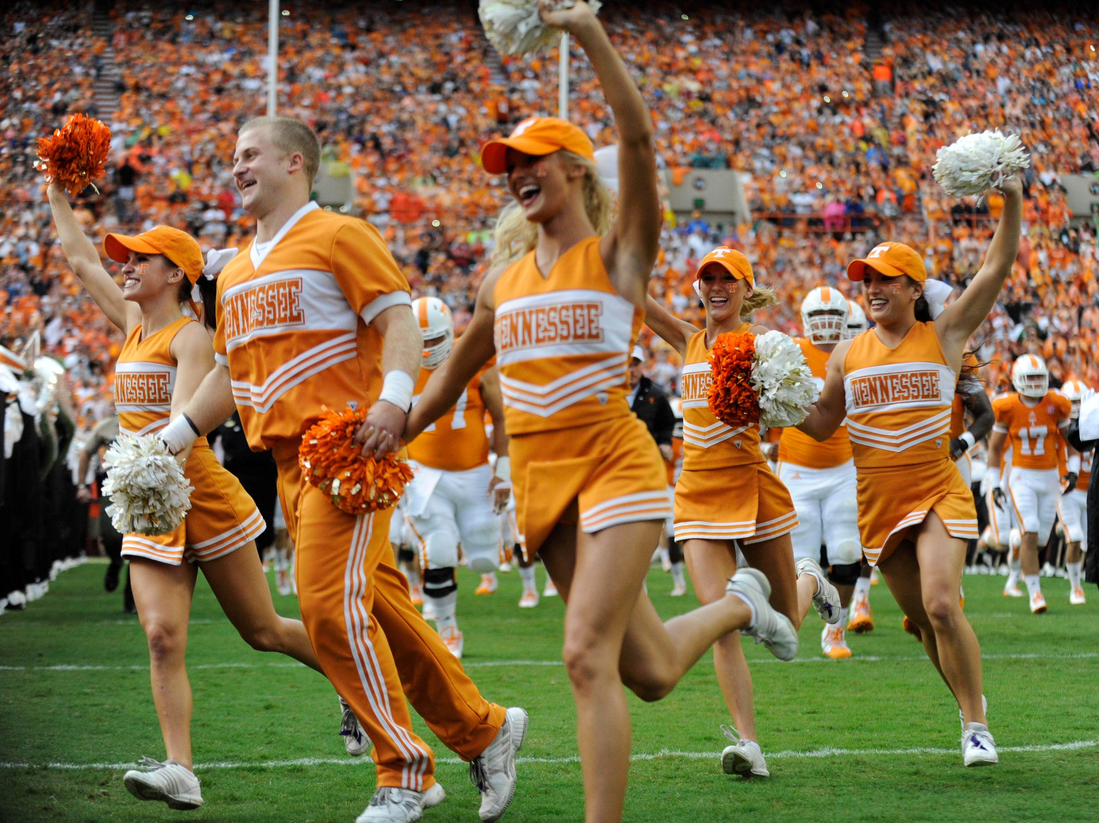 Tennessee cheerleaders take the field before the game against Utah State at Neyland Stadium, Sunday, Aug. 31, 2014 in Knoxville, Tenn.