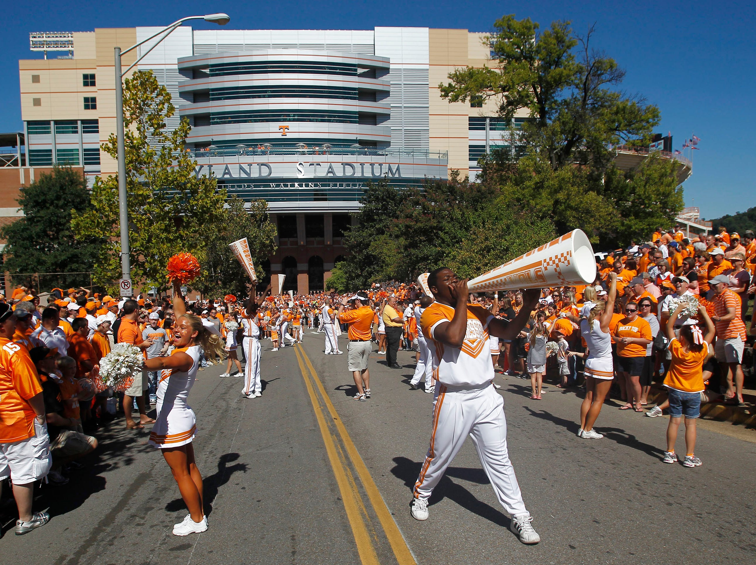 Tennessee cheerleaders yell to fans before an NCAA football game against Tennessee-Martin at Neyland Stadium on Saturday, Sept. 4, 2010, in Knoxville, Tenn.