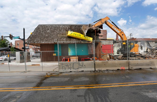 The former Fresh Mix and Where Else? Bar are demolished Thursday, July 26, 2018, at the corner of Northwestern Avenue and State Street in West Lafayette. A five-story, mixed-use project, including a Target store on the street level, will be built at the location.