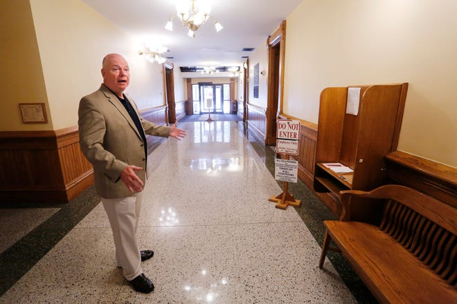 Former Tippecanoe County Sheriff and current county commissioner Tracy Brown shows on Thursday, July 26, 2018, where a truck loaded with explosives ended up during an attempted bombing of the Tippecanoe County Courthouse twenty years ago. Whoever attempted the bombing drove the truck through the doors (background) on the east entrance of the building.