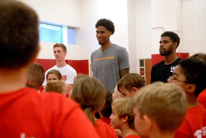 Former UofL basketball player, Ray Spalding, who now plays for the Dallas Mavericks speaks to children at the Robbie Valentine basketball camp at the YUM! Center.   July 26, 2018