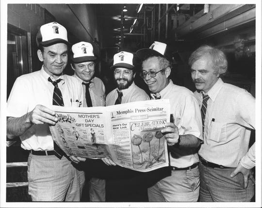 News editor and future novelist Vince Vawter is second from left as some Memphis Press-Scimitar editors check out the paper's new tabloid-format weekend edition in 1982. Also pictured are, from left, the late Fred Chisenhall, assistant managing editor; Charles Curro, graphics editor; the late George Lapides, sports editor; and Jim Willis, city editor.