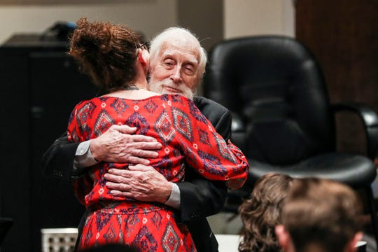 Jim Stewart receives a hug during the July 25 ceremony in which he donated his fiddle to the Stax Museum of American Soul Music.