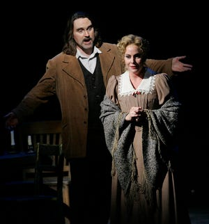 "Robin Follman (right) and William Joyner perform in the Florentine Opera's production of ""La Boheme"" in 2005. In a recent Washington Post article, Follman said former Florentine general director William Florescu sexually harassed her  in Milwaukee."
