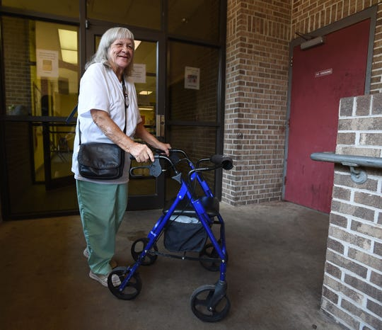 Salvation Army resident Pauline Wall walks through a breezeway after lunch Thursday, July 26, 2018, in Montgomery, Ala. Director Anthony Glenn, who has been serving as Wall's case manager, wants to bring more case managers into the shelter through a program called Pathway of Hope because he believes clients like Wall need more individualized attention and assistance to ensure self-sufficiency.