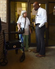 Salvation Army resident Pauline Wall, left, talks with director Anthony Glenn after lunch Thursday, July 26, 2018, in Montgomery, Ala. Glenn wants to bring case managers into the shelter through a program called Pathway of Hope because he believes clients like Wall need more individualized attention and assistance to ensure self-sufficiency