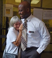 Salvation Army resident Pauline Wall, left, talks with director Anthony Glenn after lunch Thursday, July 26, 2018, in Montgomery, Ala. Glenn wants to bring case managers into the shelter through a program called Pathway of Hope because he believes clients like Wall need more individualized attention and assistance to ensure self-sufficiency.