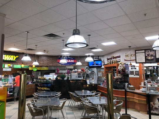 The Town Market on Immokalee Road in North Naples includes a post office, dry cleaners, Subway, ice cream and Cuban grill.