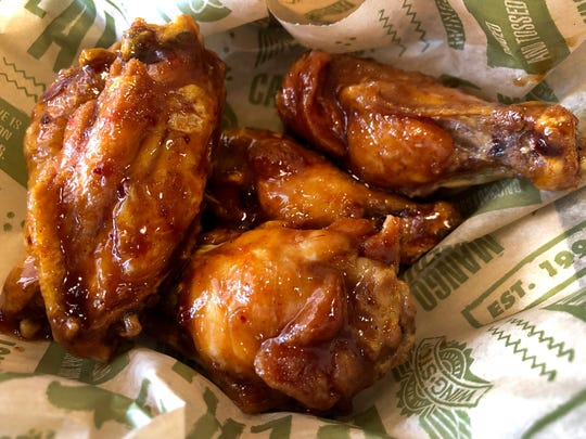 "Wing Stop's latest addition, Spicy Korean. The menu says, ""It starts off with a touch of honey and then hits you with a spicy kick of sriracha chili sauce. These wings are sure to satisfy your crave."" Meal for 2; With bone-in choice 15 wins 2 favores 2 dips,  $20.99. National Chicken Wing Day is July 29, so where can you find great wings in Collier and south Lee counties?The photo was taken in Naples, FL. Tuesday  July 14, 2018."