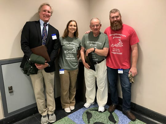 The main advocates for the state microbe bill include, from left, John Warhol, president of the Warhol Institute; and Jessica Lisa, Douglas Eveleigh and Jeff Boyd, all professors of microbiology at Rutgers University. They attended the Senate voting session in Trenton on July 26, 2018.