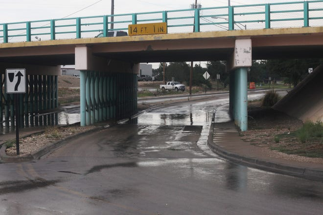 Large puddles of water form underneath a bridge over San Jose Boulevard, July 26, 2018 in Carlsbad.