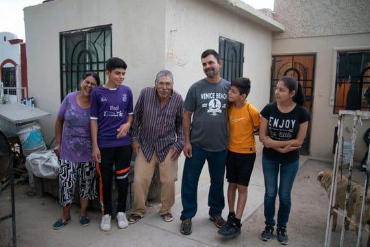 Adrián Hernández with his parents, two of his children and a neighbor (left to right: María del Carmen Garay Balderrama, Bryan Garay, Antonio Hernández, Adrián Hernández Garay, Jacob Adrián Hernandez, April Janette Hernandez) at Adrián's home in Juárez, Mexico.