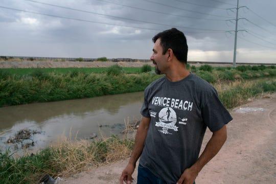 Adrián Hernández looking toward the border fence near his home in Juárez, Mexico.