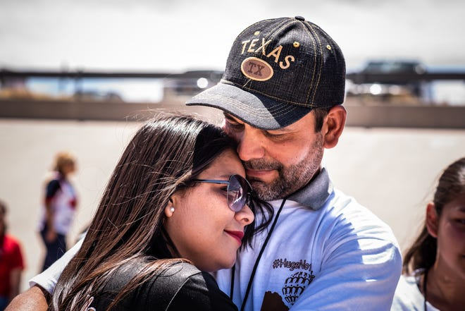 Gabriela Castañeda and Adrián Hernández at the border at the Hugs Not Walls Event, 2018.