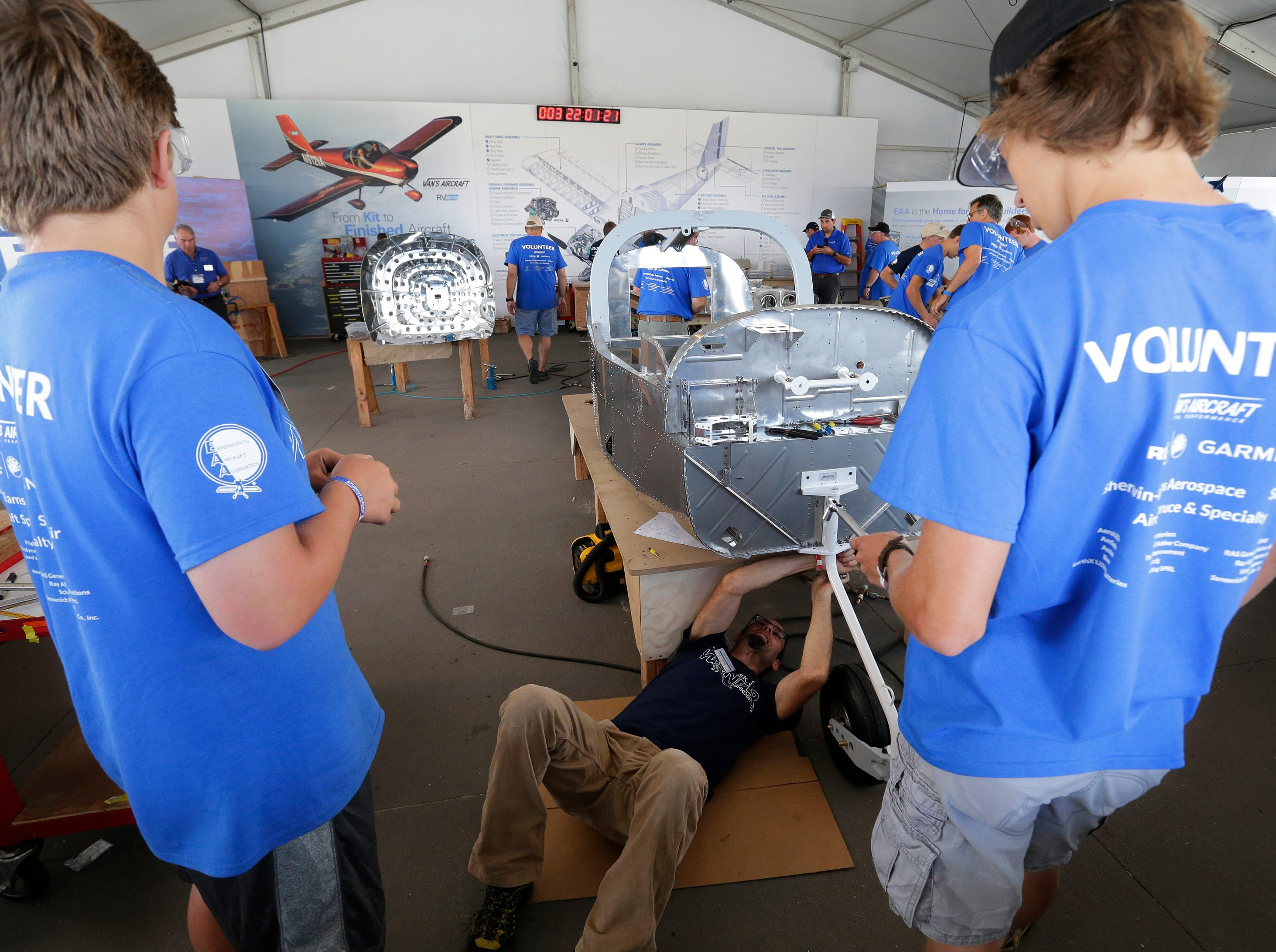 Ed Chesney attaches the front landing gear and wheel on the One Week Wonder, Thursday, July 26, 2018, in Oshkosh, Wis.  The 66th annual Experimental Aircraft Association Fly-In Convention, AirVenture 2018 draws over 500,000 people and over 10,000 planes from more than 70 nations annually to the area.  The convention runs through July 29.
