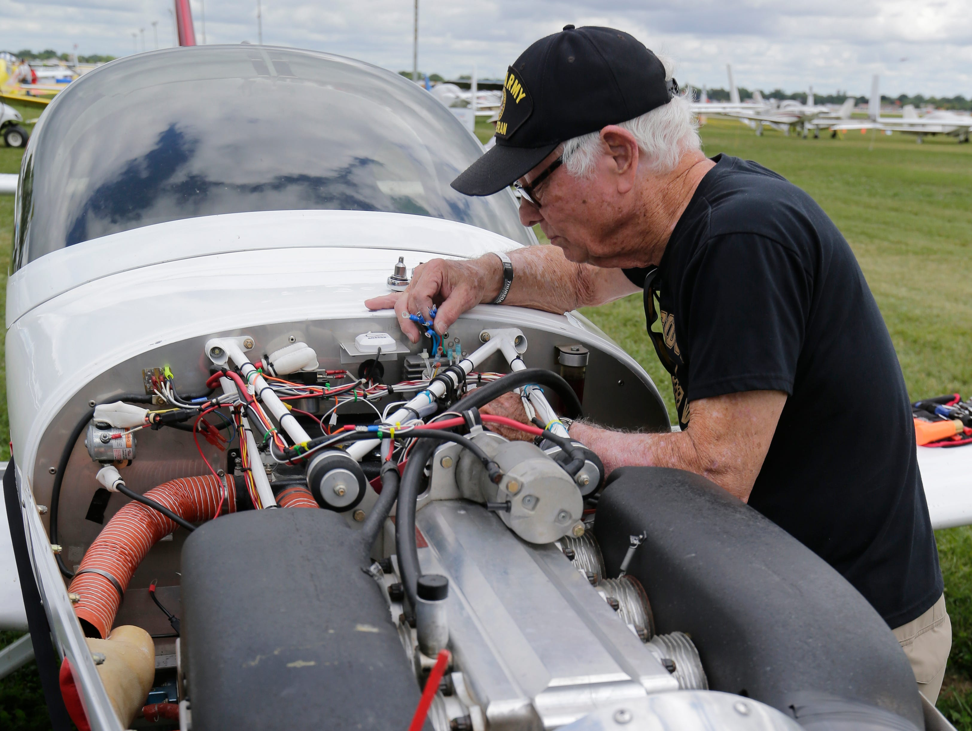 Joe Reaves of Longview, Tex., replaces the voltage regulator on his Arian Lightning, Thursday, July 26, 2018, in Oshkosh, Wis.  The 66th annual Experimental Aircraft Association Fly-In Convention, AirVenture 2018 draws over 500,000 people and over 10,000 planes from more than 70 nations annually to the area.  The convention runs through July 29.Joe Sienkiewicz/USA Today NETWORK-Wisconsin