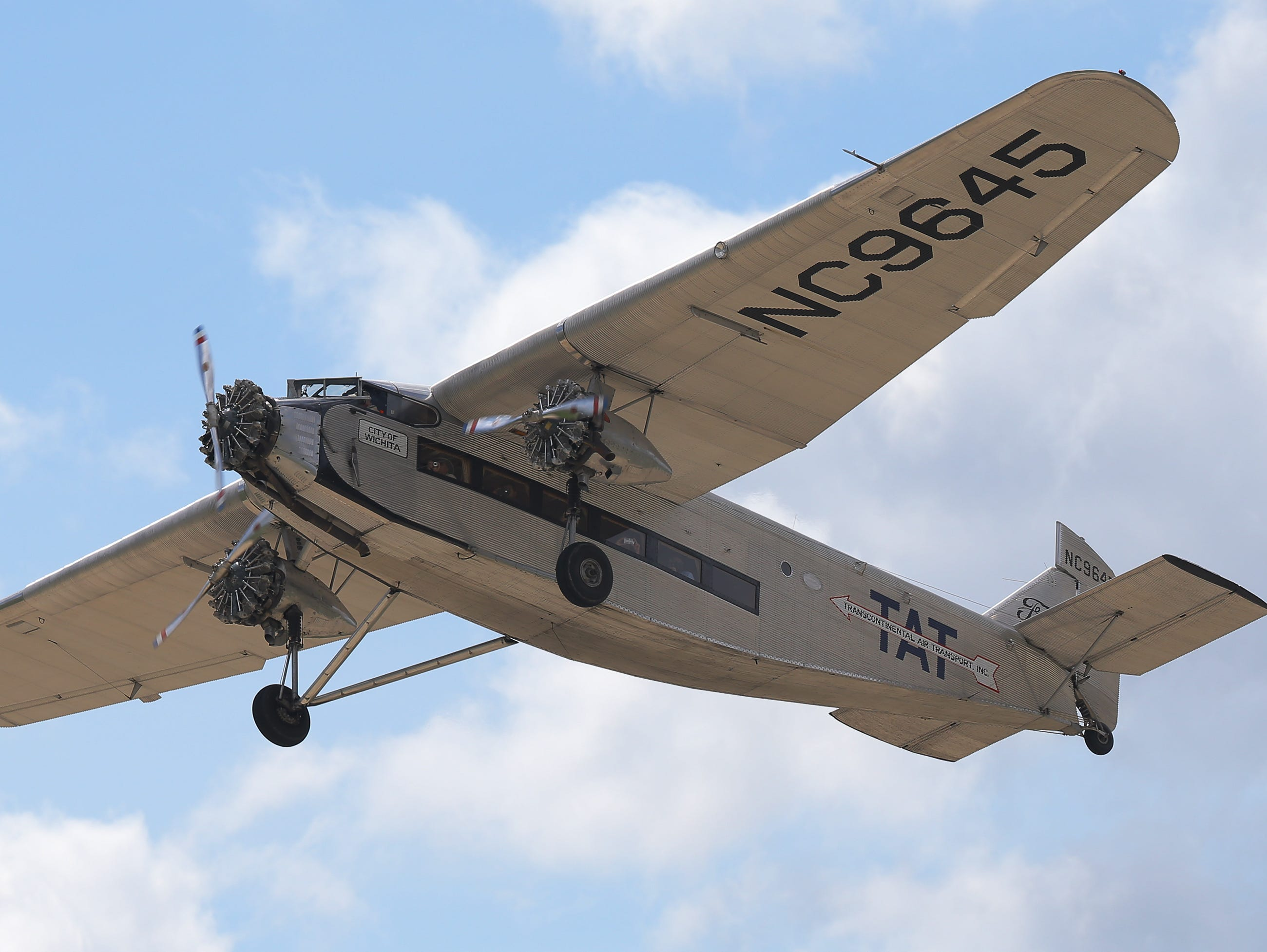 A Ford tri-motor that is giving rides takes off, Thursday, July 26, 2018, in Oshkosh, Wis.  The 66th annual Experimental Aircraft Association Fly-In Convention, AirVenture 2018 draws over 500,000 people and over 10,000 planes from more than 70 nations annually to the area.  The convention runs through July 29.Joe Sienkiewicz/USA Today NETWORK-Wisconsin