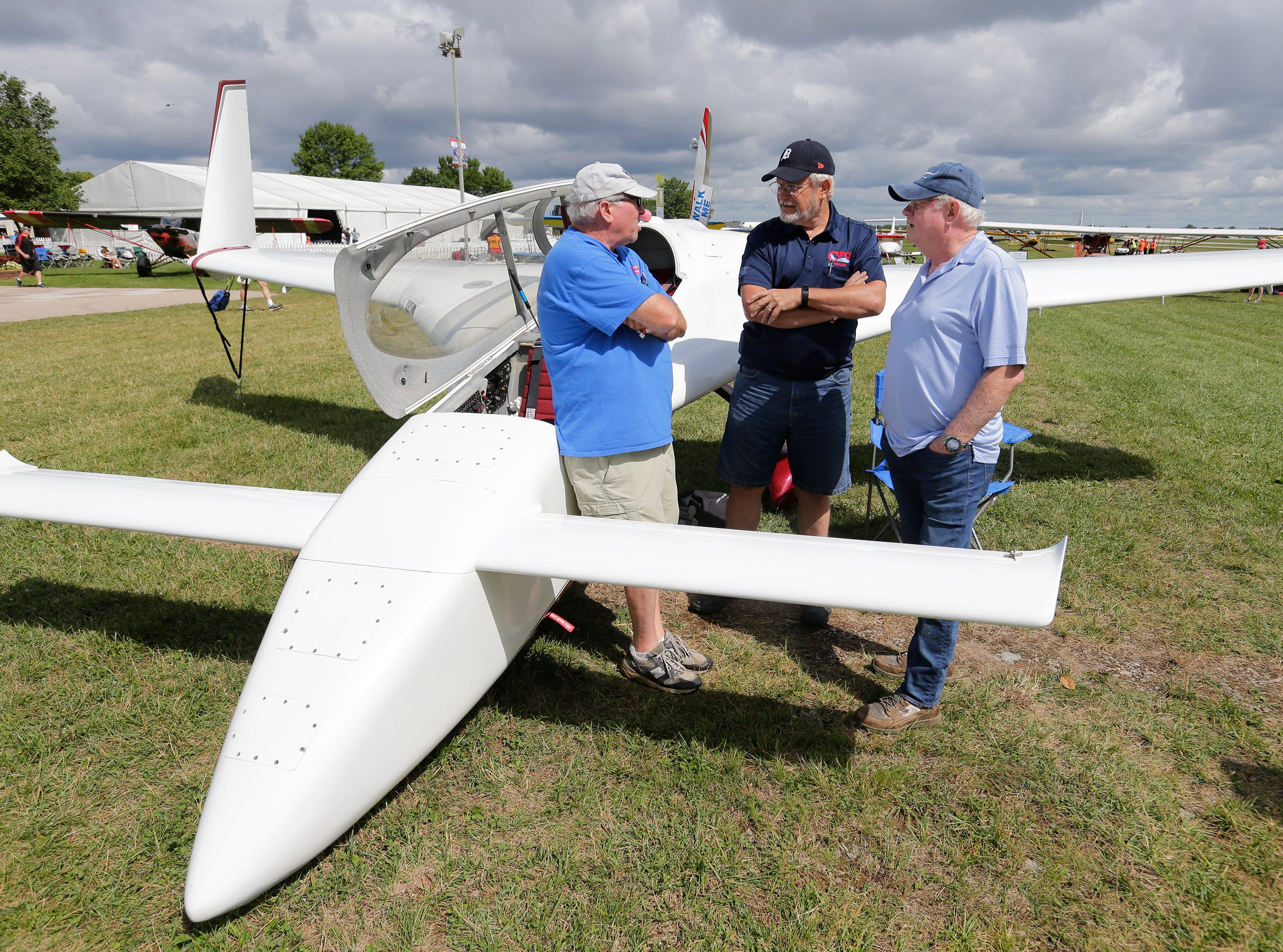 Bob Stevens of Indianapolis, Ind., leans on his 1989 Long Ez as he talks with with Steve Kay of Kokomo, Ind., and Jerry Mundell of Indianapolis, Ind.,Thursday, July 26, 2018, in Oshkosh, Wis.  The 66th annual Experimental Aircraft Association Fly-In Convention, AirVenture 2018 draws over 500,000 people and over 10,000 planes from more than 70 nations annually to the area.  The convention runs through July 29.Joe Sienkiewicz/USA Today NETWORK-Wisconsin