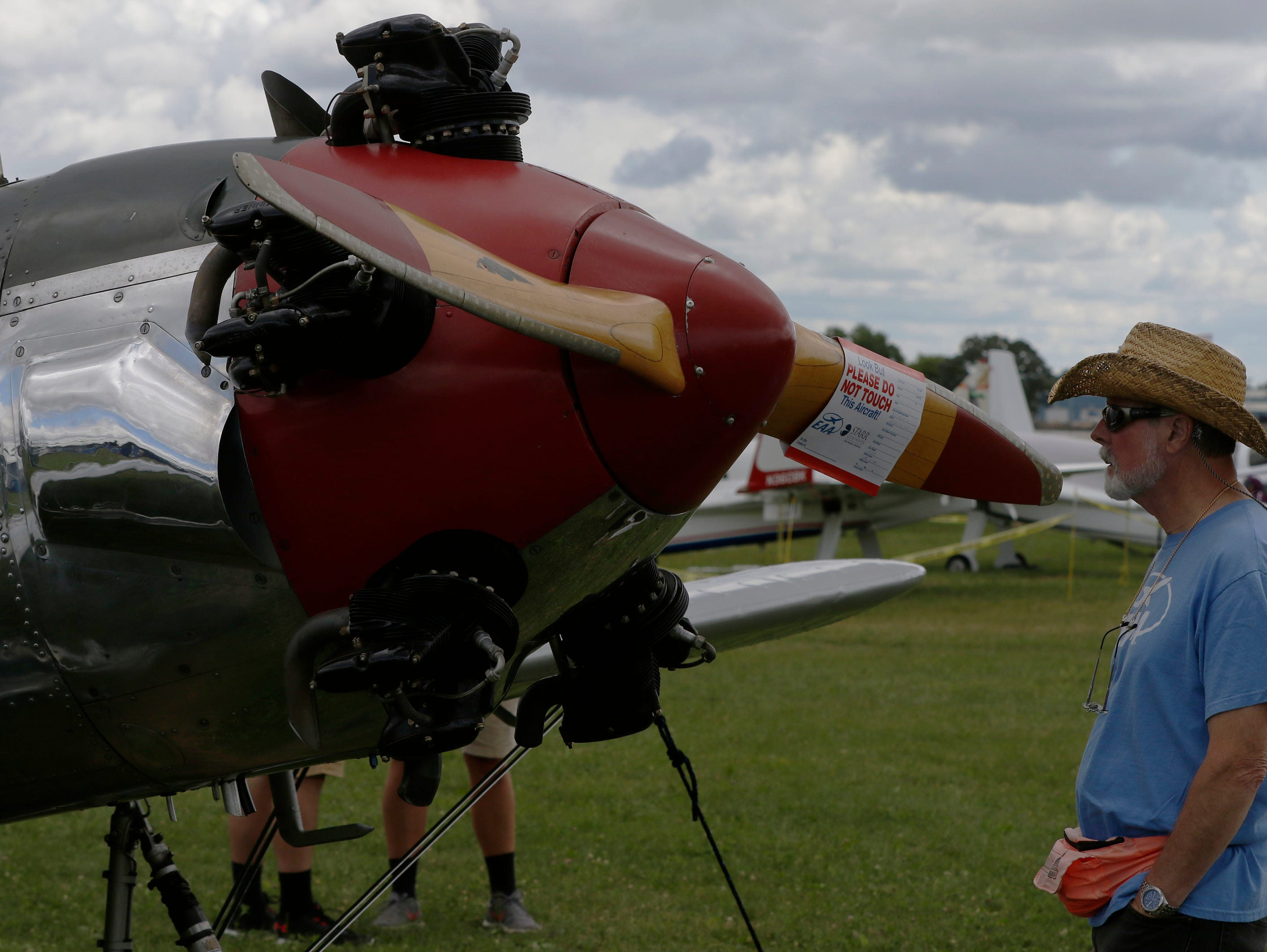Wayne Seyller of Bartlett, Ill., looks over the 1947 Ryan PT-22, Thursday, July 26, 2018, in Oshkosh, Wis.  The 66th annual Experimental Aircraft Association Fly-In Convention, AirVenture 2018 draws over 500,000 people and over 10,000 planes from more than 70 nations annually to the area.  The convention runs through July 29.Joe Sienkiewicz/USA Today NETWORK-Wisconsin