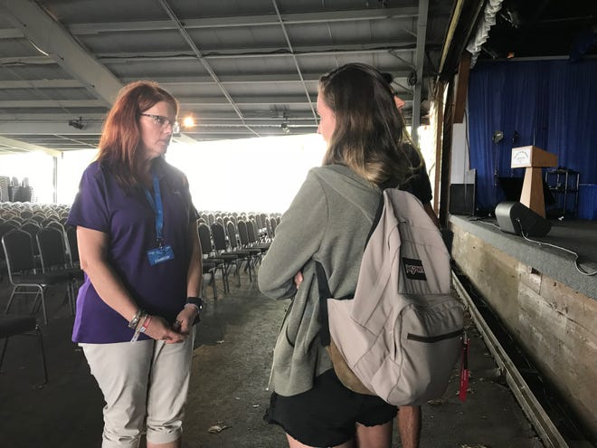 NASA Launch Director Charlie Blackwell-Thompson speaks with a student after her talk at EAA AirVenture 2018.