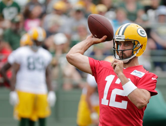 Green Bay Packers quarterback Aaron Rodgers (12) throws during training camp practice at Ray Nitschke Field on Thursday, July 26, 2018 in Ashwaubenon, Wis. 