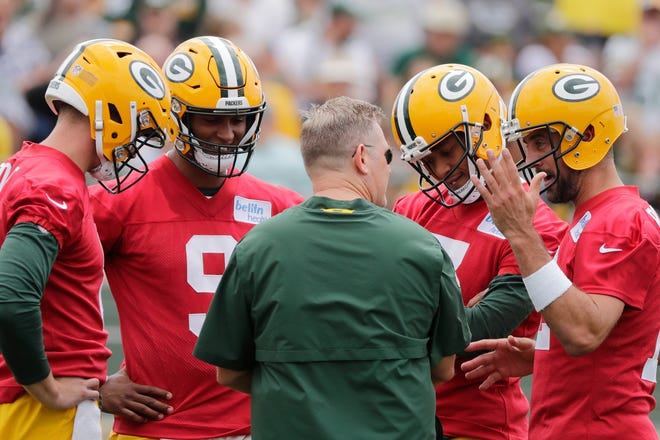 Green Bay Packers quarterbacks Tim Boyle (8), DeShone Kizer (9), Brett Hundley (7), and Aaron Rodgers (12) huddle during training camp practice at Ray Nitschke Field on Thursday, July 26, 2018 in Ashwaubenon, Wis. Adam Wesley/USA TODAY NETWORK-Wisconsin